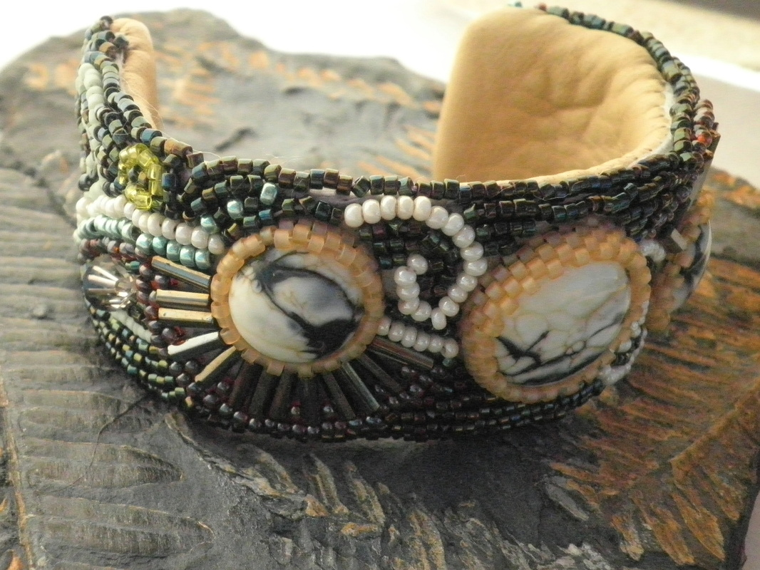 Hand beaded bracelet with lampworked cabochons